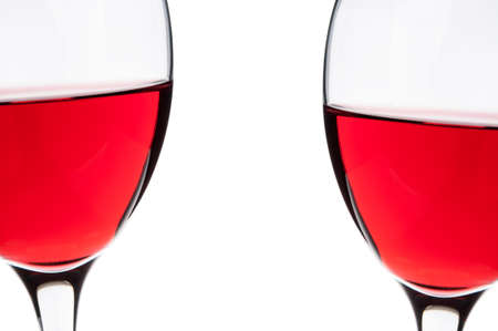 Glasses of red wine isolated on white background photo