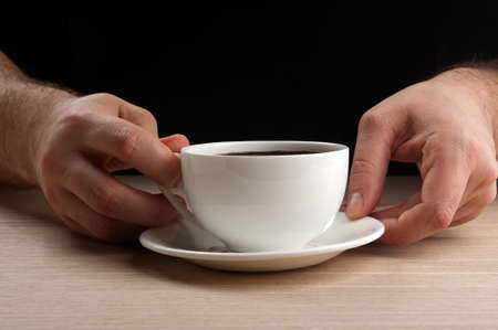 man holding cup of coffee on background Stock Photo