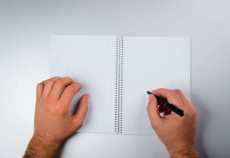 Man write on a notebook background photo