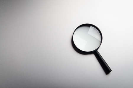 Magnifying glass on a background