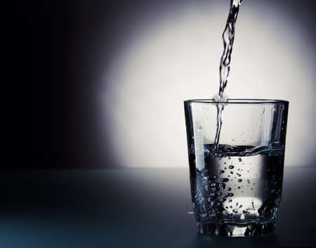 cold water pouring into a glass