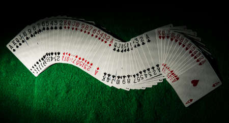 set of cards on a poker table