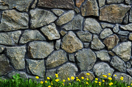 rock stone wall and green grass photo