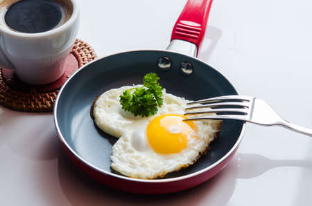 creative morning breakfast with heart eggs