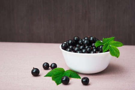 fresh currant berry with green leaf photo