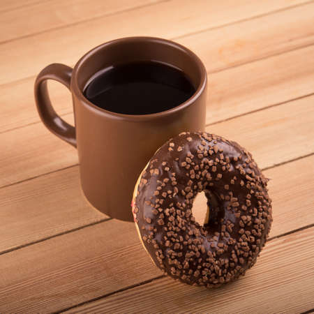 chocolate donut and cup of coffee photo