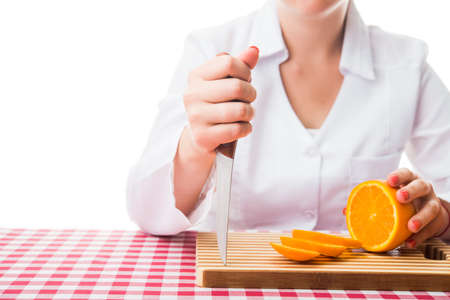 woman with knife and fresh orange photo