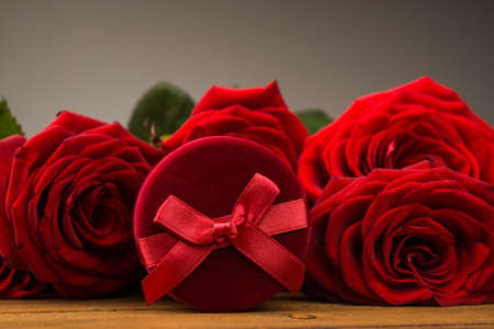 Romantic red roses with box gift. Valentine day background. photo