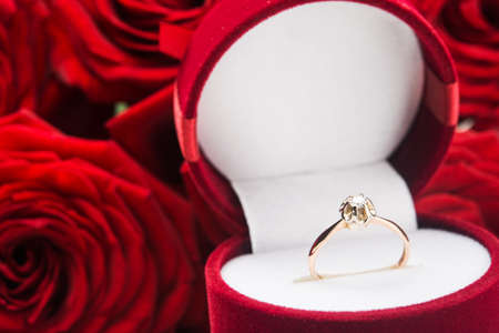 Close up of golden ring. Gift on Valentine day. photo