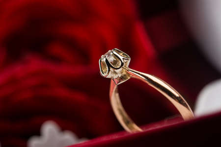 Closeup of golden ring. Valentine day. photo