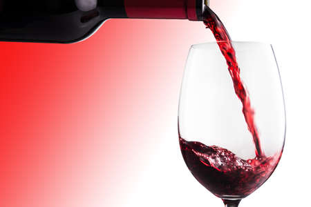 poured: Poured red wine into glass