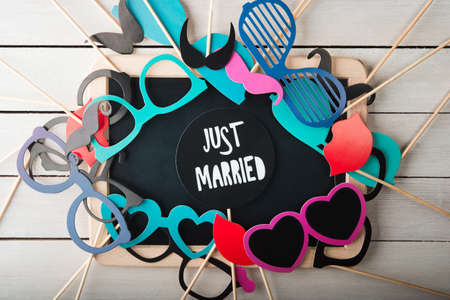 Wedding accessories set on wooden background