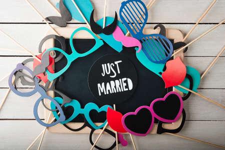 Wedding accessories set on wooden background photo