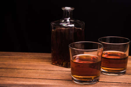 Whiskey drinks on wood table photo