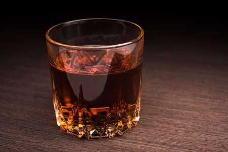 cognac: Glass of cognac on background Stock Photo