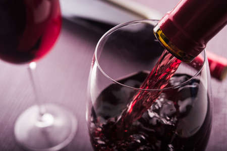 wine tasting: Poured red wine into glass
