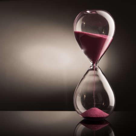 Sand hourglass on glass table