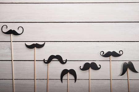 Wedding accessories set moustache on white table Standard-Bild