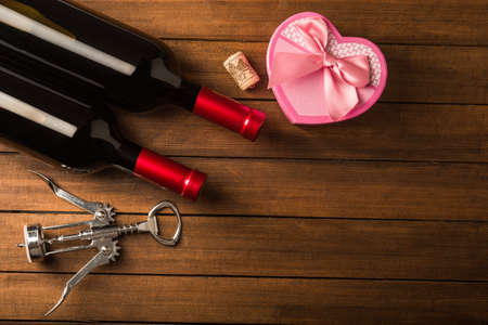 Romantic dinner with a gift and wine bottles photo