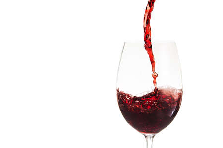 pouring wine: Glass with red wine isolated on white background