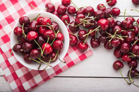 Fresh cherries in a white plate. Top view.