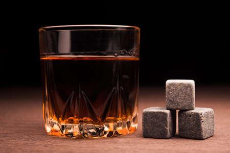 whiskey bottle: Whiskey beverage in glass. Alcohol background.