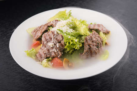 fume: salad with beef in fume white dish