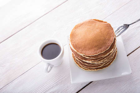 pancake: Tasty pancakes with coffee cup on white wood table Stock Photo