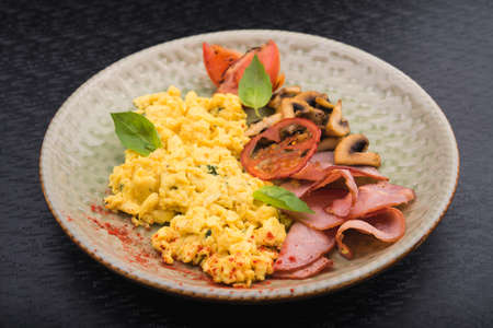 bacon and eggs: hearty meal with bacon, eggs and mushrooms