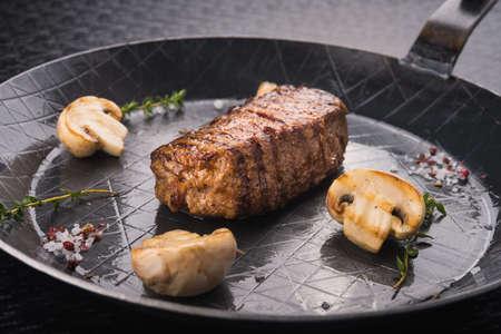 medium close up: steak dinner on metal pan