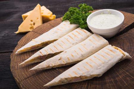 pita: pita with cheese on wood board