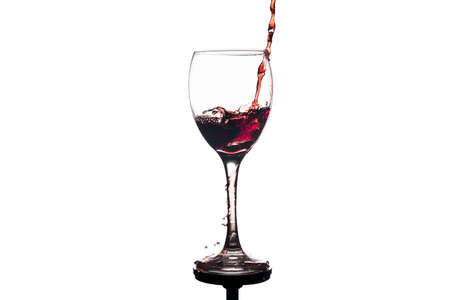 red wine splash in glass isolated on white background