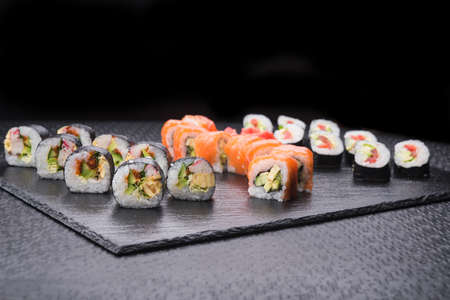 sushi set rolls on cold stone board Stock Photo