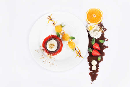 chocolate fondant with orange fruit and strawberry. top view.