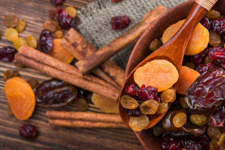 Mix of dried fruit in clay bowl. healthy food background