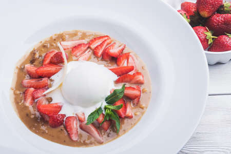 Strawberry with ice cream and mint. summer dessert food
