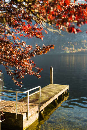A wooden pier on the Hallstatt lake, against the background of the mountains. Austria Stock Photo