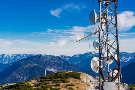 communication antenna in a top of mountain, television and radio signal technology at sky background