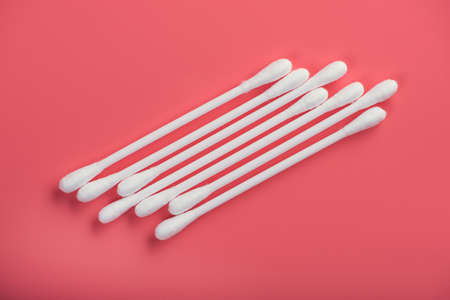 closeup of cotton buds on pink background 스톡 콘텐츠