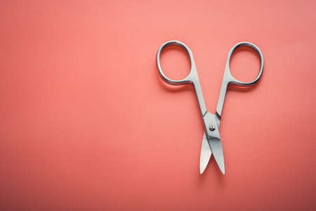 Cosmetic scissors on pink background. manicure tool equipment Stock Photo