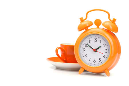 time for a coffee break, orange cup and alarm clock isolated on white background Reklamní fotografie