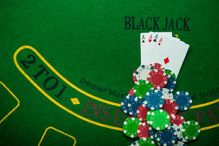 four ace in poker game. casino chips. chance to win the game