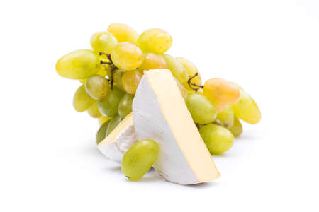 fresh camembert cheese with grapes isolated on white background 写真素材
