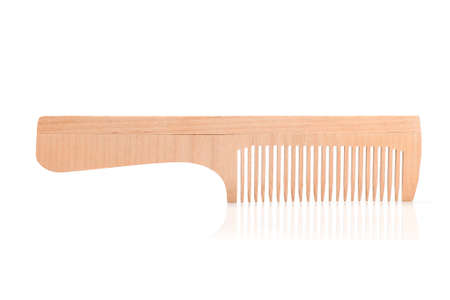 wooden beauty comb isolated on white background