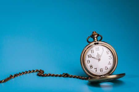 golden retro stopwatch on a blue background. time equipment Foto de archivo