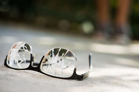 broken glasses on the asphalt. street accident concept. poor eyesight
