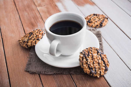 morning coffee cup with chocolate cookies on a wooden table Stock Photo