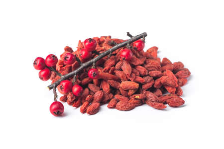 Goji berries with branch contain many useful substances, vitamins and minerals isolated on white background Imagens