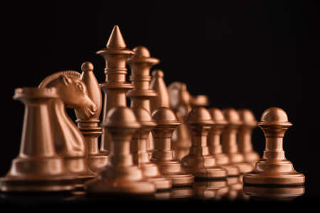 golden chess figure on a black table. intellectual game Stock Photo