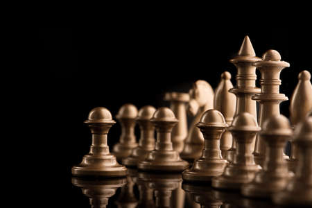 golden chess figure on a black table. intellectual game